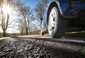38424650 - car on asphalt road in spring morning